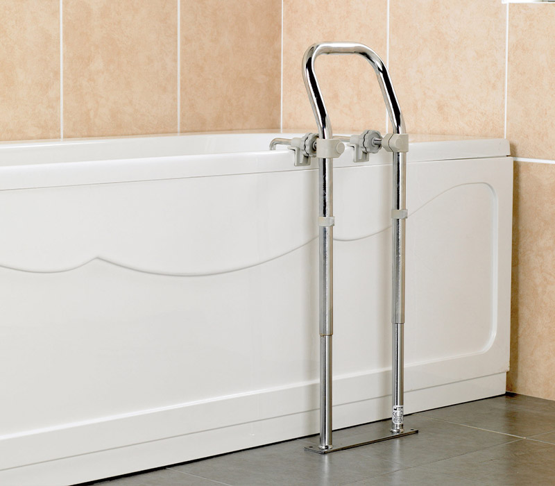 Tall support rail attached to bath