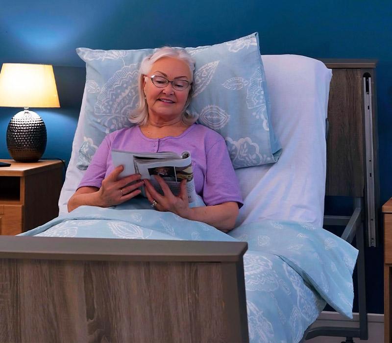 Elderly Woman using Adjusting Bed at night