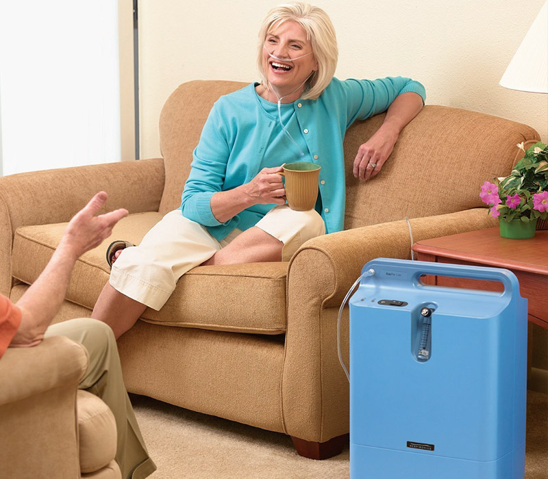 Elderly woman using Philips Oxygen Concentrator