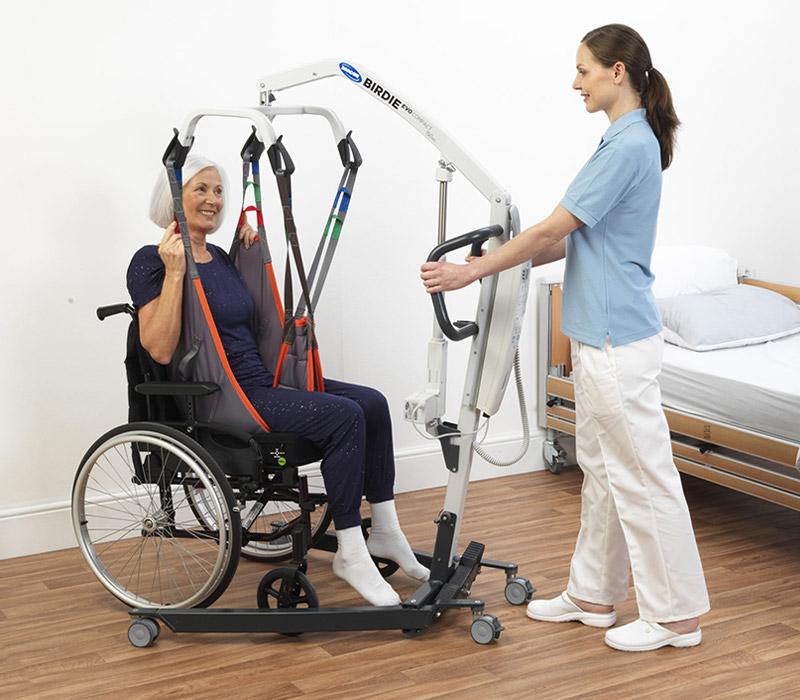 Elderly Lady in Hoist Lift from Wheelchair