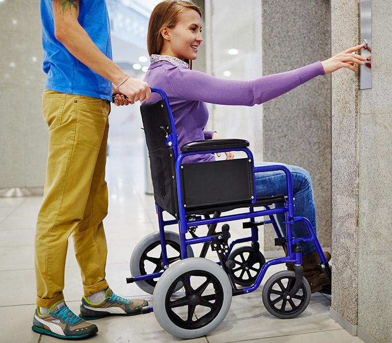 Lady Wheelchair User in Transit